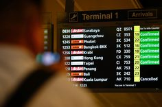 A flight information signboard shows the status of AirAsia flight QZ 8501 from the Indonesian city of Surabaya to Singapore at Changi Airport in Singapore December 2014 (Reuters / Edgar Su ) Search Party, Search And Rescue, City State, Krabi, New Market, Guangzhou, Borneo, Surabaya, Phuket