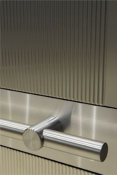 Brushed stainless steel tubular handrail.   Elevator Interiors by SnapCab (Pattern 5HR)