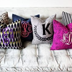 Monogrammed pillows. Love the mix and match of the colors and types of monograms!