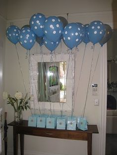cute...each guest gets a favor bag with a balloon tied to it.