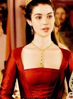 Adelaide Kane as Merissa from the Sword of Truth series. Merissa was around the same age as Nicci and said to be on par with her extraordinary beauty. Her hair was full and dark brown and her eyes were cold and dark. She was often clothed in dresses that were red in color. Merissa rarely allowed emotion to touch the attractive features of her face and her heart was said to be made of black ice. It was said that her dark eyes were a window into her black heart.