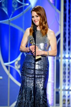 """Onstage, Moore thanked filmmakers Richard Glatzer and Wash Westmoreland for making a movie about a middle-aged woman and for allowing her to be a happy person, which her mother always defined as """"someone who had work and love."""" Moore then thanked her family for giving her that love."""