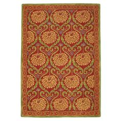 $1425 6'x9' The lush abundance of zinnia blossoms is captured and celebrated in this richly colored tufted wool rug. The large-scale flowers are surrounded by intricate scrolls and a lively border. 100% wool, tufted.  GoodWeave certified. Cotton backing. Imported. Colors: Poppy or Citron.