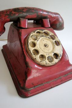 Vintage red toy phone. The worn receiver shows that it was well loved.
