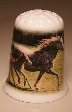 Horse with foal porcelain thimble These are for sale by https://www.speelgoedenverzamelshop.nl/vingerhoedjes/dieren/paard_met_veulen_bedrukt_op_een_porselein_vingerhoedje_(hmpaard07).html