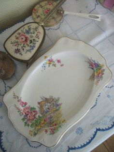 """Pareek Sandwich Plate c 1930s by Johnson Brothers China. Lovely elongated shape with pretty cottage garden design & gold/black finish. 11:"""" x 7"""" with fluted corners.  $19.67 at bellemoonvintage on etsy."""
