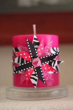 decorate a candle with ribbon. So easy. Cute cheap gift or favor from a party. Could change colors/patterns for anything!