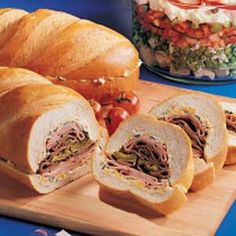 Sandwich for a crowd.   Always a hit.  Italian bread, cream cheese softened,  shredded cheddar cheese, sliced green onions, mayonnaise, Worcestershire sauce, thinly sliced fully cooked ham,  thinly sliced roast beef, sliced dill or bread-n-butter pickles.