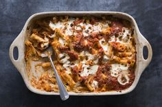 "We know ricotta is a traditional addition to baked ziti, but it has a tendency to get dry and grainy when baked. Our update uses a creamy Parmesan béchamel, in addition to a tangy tomato sauce, which together make for a super flavorful finished dish—that won't dry out in the oven. This is part of <a href=""http://www.bonappetit.com/best"">BA's Best</a>, a collection of our essential recipes."