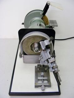 Drill sharpening fixture added to old bench grinder