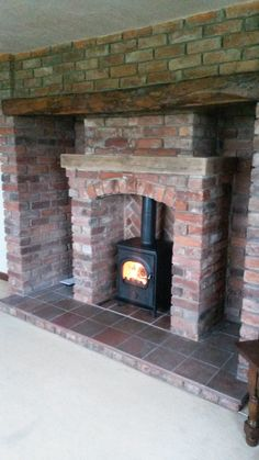 Alpha II Multi Fuel Stove and Brick Fireplace