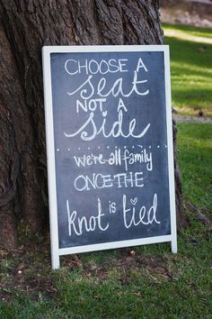 Choose a seat , not a side. We're all family once the knot is tied. Chalkboard wedding reception seating sign.  Lauren Kriedemann Photography http://www.confettidaydreams.com/franschhoek-wedding-in-white/
