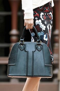 Structured dome satchel with sophisticated raised quilting in woodland green