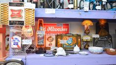Rediscover retro decor pieces on sale at Crazy Grandpa's Antiques in Oklahoma City. Goods from many eras can be found on the shelves here, from a 1920s carved eagle to a 1960s candy machine.