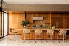 Marmol Radziner Designs a Modern Home in Beverly Hills - kitchen is outfitted with walnut cabinetry