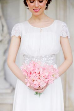 Simple modest wedding gown- I like the silver in the waistband and the long silhouette.