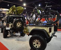 Yes...I absolutely need a Jeep Wrangler with a luggage cage/rack so it can carry my kayak. Plus I'll also need a gear trailer equipped with a bike rack for my MTB. Can I have it in an olive green or copper though? Thanks!