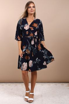 I just adore this gorgeous wrap front tea dress! The navy blue flower print pattern and flowy knee length makes for a comfortable, yet flattering fit. I keep this in my wardrobe for summer events like weddings, church, communion, confirmation, dinner out, and to wear on vacation. I adore the simple yet classy look. People will take notice of you in this beautiful dress from the Virgo Boutique Store! Check out all their luxury women's apparel. #floral #dresses #womensfashion… Elegant Fashion Wear, Summer Events, Cute Skirts, Occasion Wear, How To Look Classy, Floral Dresses, Confirmation, Communion, Virgo