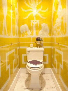 """1/2 Bath - I usually hate """"toilet"""" shots but this is simply fabulous. Yellow is the perfect color for this small bathroom, and the greek key pattern is definitely a favorite of mine."""