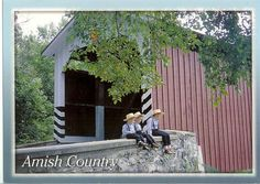 USA - Pennsylvania - Amish Boys at Covered Bridge