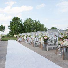 Aisle decor: galvanized buckets for flowers: A Romantic Summer Wedding in Bristol, VA