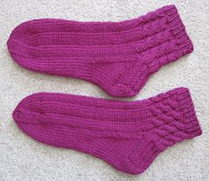 Pretty socks knit top-down in the round with mirrored cables. Work up quickly in worsted weight yarn at 6 st/inch. You could also use a sport/dk if you can get that gauge with them. I use these as slippers! they are quick to knit and comfortable to wear! Knitted Slippers, Knitting Videos, Knitting Socks, Knit Patterns, Crochet, Ravelry, Wool, Lady, Pretty