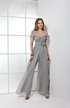 Demetrios Evening Style E142 by Demetrios - Chiffon Pantsuit with a Ruched, strapless, sweetheart bodice finished with flower on waist. matching short sleeve bolero jacket.