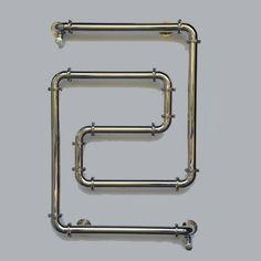 En acier inox satiné, ce chauffage central Varela semble tout droit sorti des années 30. Design et original, il réchauffe vos pièces avec style. Dim. : H974 x L 680 mm. Puissance : 280W.chauffage, radiateur, varela, chauffage varela, radiateur varela