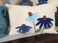 A personal favorite from my Etsy shop https://www.etsy.com/listing/502421822/blue-cone-flower-pillow-cover-felt