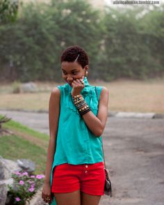The red shorts, bracelets, super cute twa...i love it all.