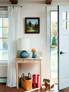 A small table placed just inside the front door adds functionality to this tiny entryway. The front door was painted white on the interior side, which creates an uninterrupted sight line.