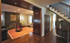 Square walnut arches define the #livingroom #entry.  #INTERIOR #DESIGN: De Space Designs | See more projects at: http://www.HandD.com/DianeTaitt