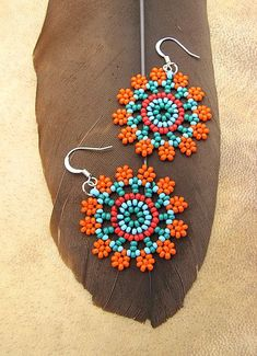 Items similar to Seed Beaded Earrings, Mandala Flower in Orange and Turquoise. on Etsy Bead Jewellery, Seed Bead Jewelry, Seed Bead Earrings, Diy Earrings, Hoop Earrings, Seed Beads, Diy Jewelry, Bugle Beads, Jewelry Making
