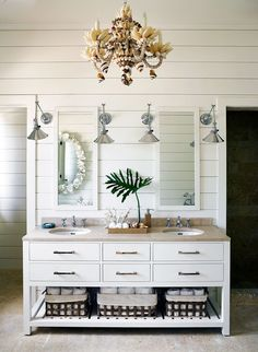Bright Bathroom - Silver sconces and a seashell covered chandelier shine down on a dual vanity.