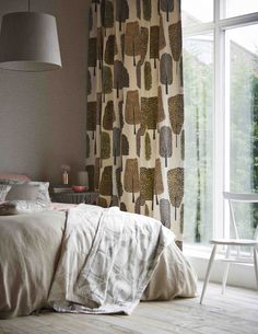 We love the contemporary neutral palette with a hint of blush in this relaxing bedroom. Featuring fabrics from Scion's Levande collection.