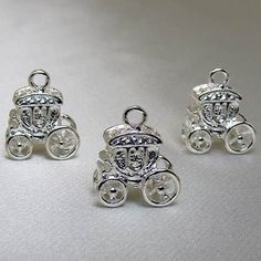 "Carriage Charms are 1/2"" and are made of metal and come in a pack of 8."