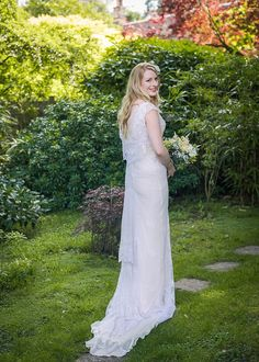 Bride wears a bespoke wedding dress made with original antique lace | Photography by http://www.julieanneimages.com/