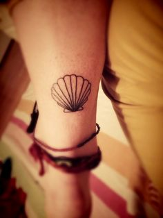 fuckyeahtattoos:  I had this tattoo done at Short North Tattoo in Columbus, OH. It was done by Miller. He did a great job! It turned out exactly how I hoped it would. I got this seashell to represent my fond childhood memories made with my family and closest friends at the beach each summer.