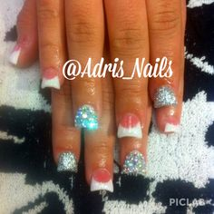 Dipped French tip acrylics with swarovski diamonds!  Follow me on Instagram at @Adris_nails :)