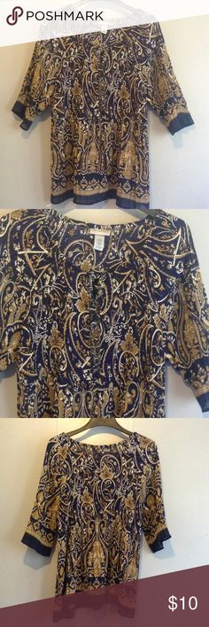 Woman petite blouse size 18/20 Catherine's Women plus petite size 18/20 navy blue, gold and white pattern fully pleated, neck has elastic 3/4 sleeves 100% polyester with front embellishment never worn no tags Catherines Tops Blouses