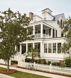 Double porches, picket fence, dormers, metal roof, sunroom <3