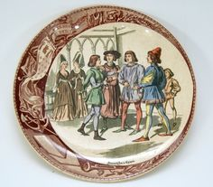 SARREGUEMINES Prato de faiança francesa decorada com cena policromada representando Joana D'Arc em C