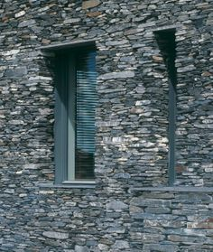 Sustainable House With Raw Stone Exterior