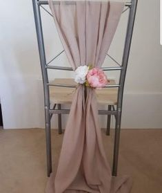Finish your wedding chairs with chiffon drapes & artificial flower arrangement, the latest trend to finish already styled wedding chairs! Artificial Flower Arrangements, Artificial Flowers, Wedding Draping, Pew Ends, Wedding Chairs, Ladder Decor, Fake Flower Arrangements, Fake Flowers, Art Flowers