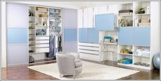 California Closets This is a soothing to eyes closet with sky blue and white tones. It has drawers, shelves and cabinets to place a variety of things. Moreover, it also has a slide out table that can be used as a mini study table.