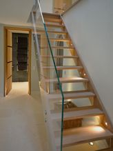 #Stairs by #LightIQ. The open #staircase is #lit from both the side and the bottom. #LD150 (#Light #Corporation) #uplights set into the floor accentuate the form whilst the LD247's (#Light #Corporation) #recessed into the side illuminate the treads for safety. The two effects combined create a #warm #glow making the #staircase a lovely feature.