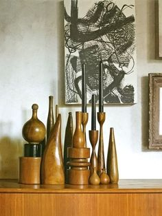 collection of teak candle holders