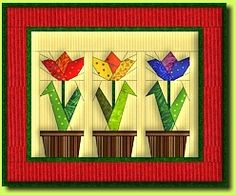 Tulips Quilt Pattern: FREE PATTERN for paper piecing. Quilt size 39 x 33 cm (15 ½ x 13 in). These patterns are intended exclusively for your own personal use. Distribution and commercial use (e.g. sale of quilts based on the patterns) are expressly prohibited.