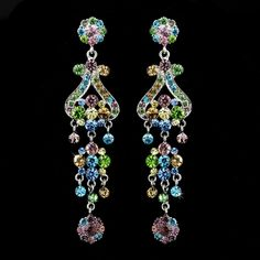 These amazing silver plated quinceanera earrings feature a lovely vintage inspired pattern encrusted with colorful Multi Colored Swarovski crystal rhi