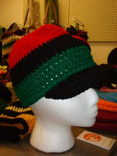 Crochet Red, Black and Green hat with a Black brim. $25.00. www.sankofalove.etsy.com